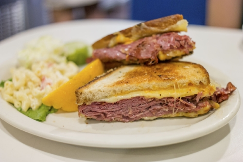 The toasty Grilled Reuben offers corned beef on grilled baker's onion rye with Swiss cheese, sauerkraut and Russian dressing is a sandwich delicacy.