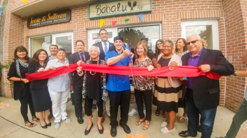 Long Islander News photo/Jano Tantongco  Inset, Babalu owner Alan Gotay cuts the ribbon at his Cuban bistro in Huntington village. Above, he's joined by local politicians and Huntington Chamber of Commerce officials.