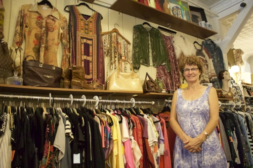 Long Islander News photos/Janee Law Helga Bagatais, above, owner of Helga's Choice Consignment, left, opened the shop in July 2014, selling pre-owned items that are one of a kind.