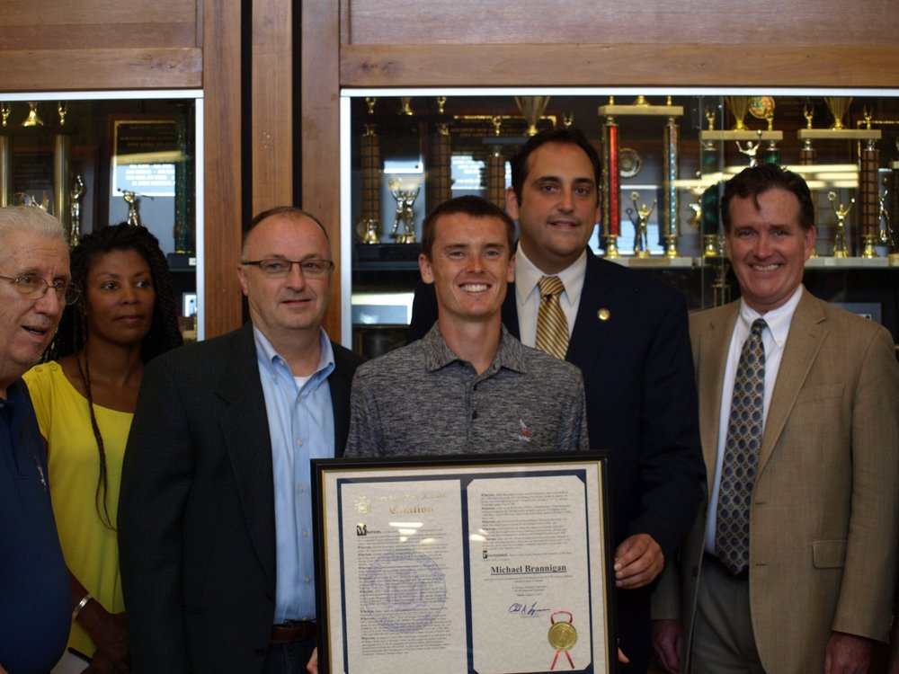 Long Islander News photo/Connor Beach  Michael Brannigan, of East Northport, proudly accepted a citation for lifetime distinction from the New York State Assembly with his gold medal from the 2016 Paralympic games on display.