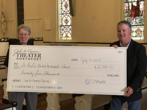 Photo Courtesy of John W. Engeman Theater at Northport Kristina Hansen, pastor of the St. Paul's United Methodist Church, accepts the first part of a $25,000 donation by John W. Engeman Theater from theater co-owner Kevin O'Neill to kick off the church's capital campaign.