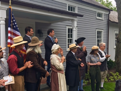 Photo/Walt Whitman Birthplace Association Congressman Suozzi, with microphone, announces the spy trail legislation with TURN: Washington's Spies actor Ian Kahn at his side.