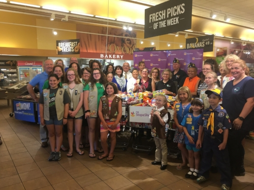 Photo by Joseph Marasciullo When school's in session, Tri-CYA helps make sure its young clients are fed. Now kids won't go hungry on weekends, thanks to contributors rallied by Huntington Councilwoman Tracey Edwards, pictured with contributors at Stop and Shop.