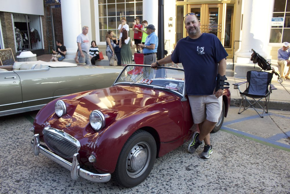 Mike Gozelski of East Northport, stands next to his 1959 Austin Healey Bug Eyed Sprite on display on Main Street.