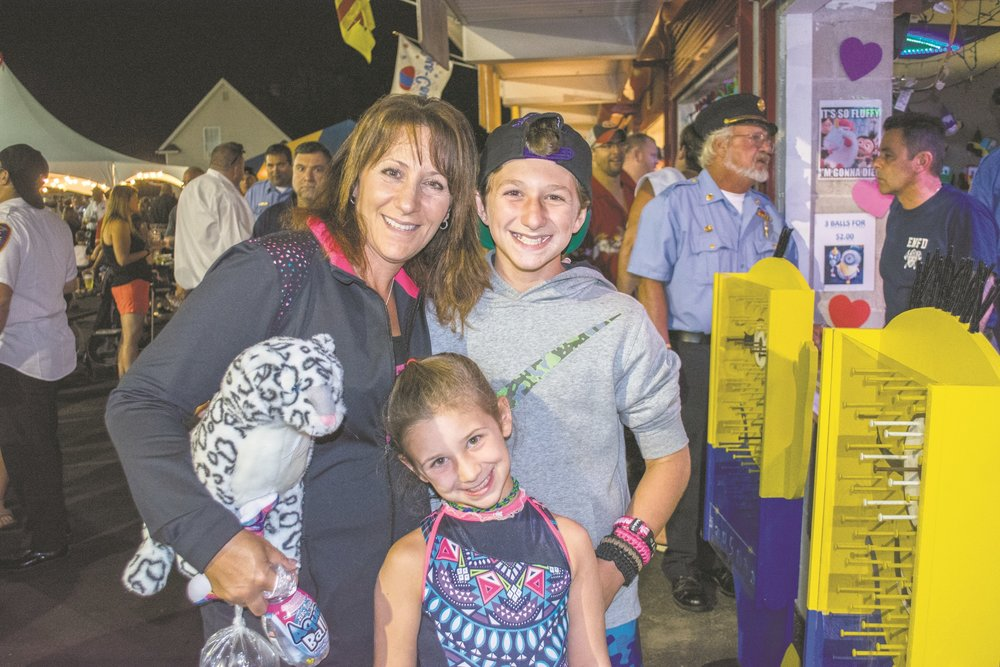 Christina McCarthy, left, of East Northport, Pictured with her kids, said she's been coming to the fair with her family for 21 years.