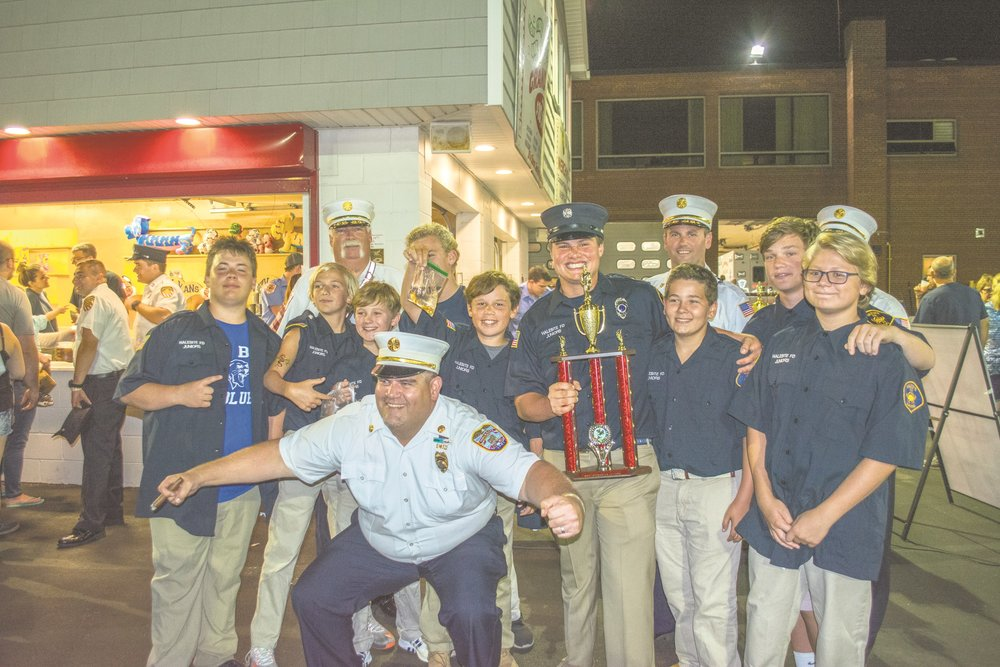 Members of the Halesite Fire Department are pictured last Wednesday night after claiming first place in the Best Appearing Juniors Category.