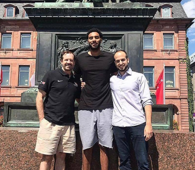 Photo courtesy of Sebastian Bartholomeaus  Chris Brady, center, and his coach, Simon Cote, left, are pictured earlier this month after Brady signed a professional basketball contract with Germany's Hanau White Wings.