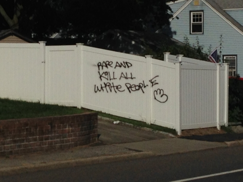 """Photo/Karen Martin Racist graffiti reading """"Rape And Kill All White People"""" is found on a Huntington Station fence Monday morning. The graffiti was removed that afternoon."""