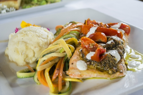 The Salmon Athena ($36) consists of fresh Scottish salmon, pistachio, potato and cauliflower puree, veggies, roasted tomatoes and tzatziki sauce.   Long Islander News photo/Barbara Fiore