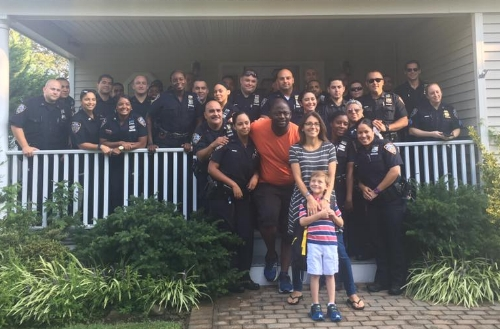Austin Tuozzolo, son of late Greenlawn resident and NYPD Sgt. Paul Tuozzolo, receives a send-off from his father's friends and fellow officers of the 43rd Precinct before his first day of kindergarten.