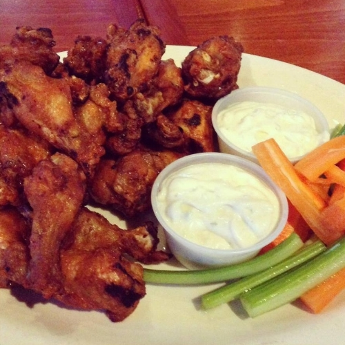 A plate of wings from Changing Times in East Northport is the perfect dish on a football Sunday.