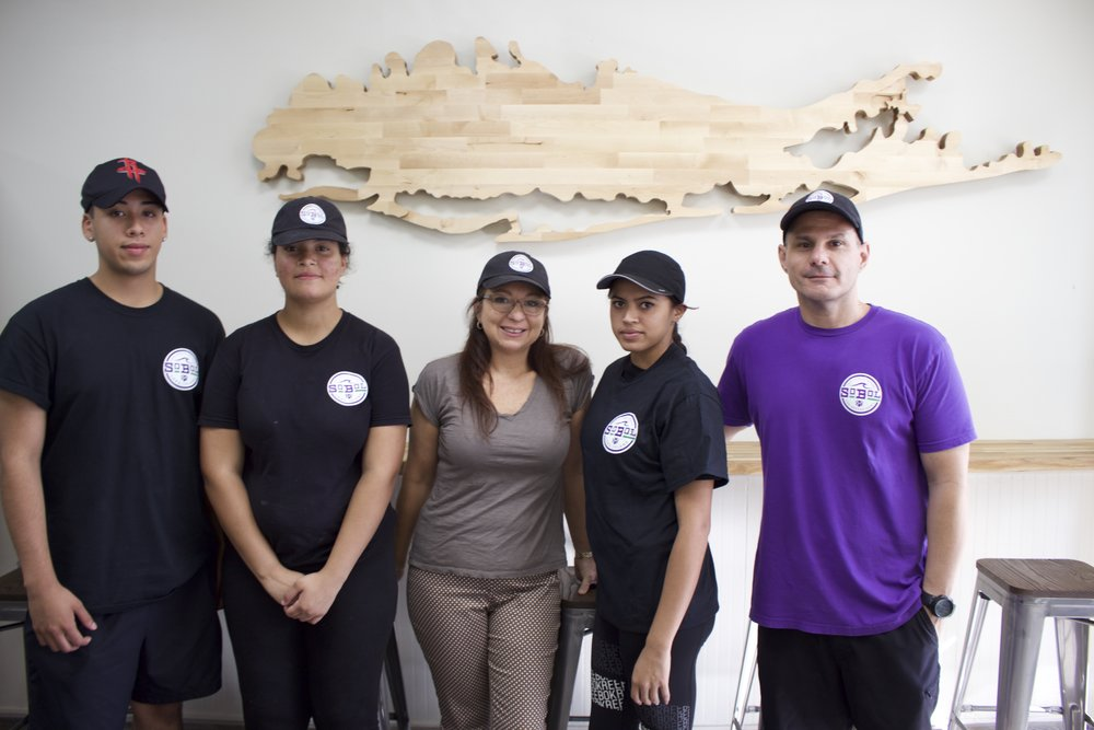 Sandra Recchione, owner of SoBol in Huntington, said the franchise is like a big family. Pictured, from left, are: Marvin Hidalgo, team member; Tessa Duff, aspiring assistant manager; Recchione; Andrea Ortiz, food prep worker; and Pat Herrera, area manager.   Long Islander News photos/Janee Law