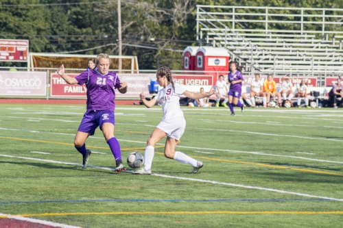 Whitman junior forward Danielle Kleet, right, cuts inside to beat a Central Islip defender and set herself up for her second goal of the young season.   Long Islander News photo/Andrew Wroblewski