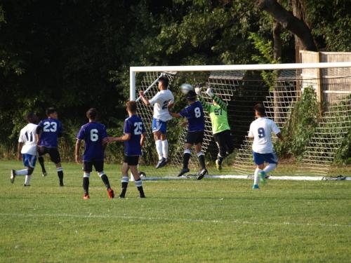 Knights forward Edwin Licona, left-center, heads a ball on net against Hampton Bays on Monday.   Long Islander News photo/Connor Beach