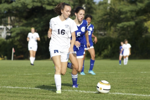 Elizabeth Cianciotti (no. 16)dribbles past a Riverhead defender.   Long Islander News photos/Janee Law