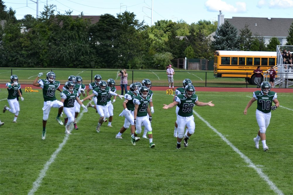 The Harborfields Tornadoes ran onto the field during their homecoming game.   Photos/Harborfields Central School District