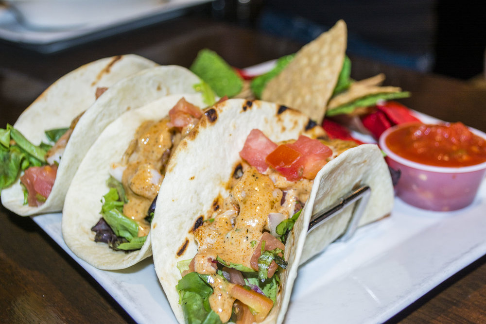 The Shrimp Tacos ($12) feature seasoned grilled shrimp, lettuce, and pico de gallo wrapped in three soft shell tacos.
