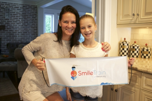 Kelli and Ella Pastorelli, along with the rest of the Pastorelli clan, have raised nearly $250,000 for Smile Train to help fund corrective surgeries for children with cleft lips and palates .  Long Islander News photos/Janee Law