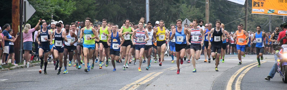 The 8:30 a.m. wave takes off on Saturday in the annual Great Cow Harbor 10K.   Photo/Ed Grenzig/Long Island Running Photos