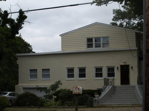 A federal lawsuit alleges the Town of Huntington did not enforce zoning violations at this 792 Larkfield Road home in East Northport after a company owned by Councilman Eugene Cook bought the property in 2014.   Long Islander News photo/Connor Beach