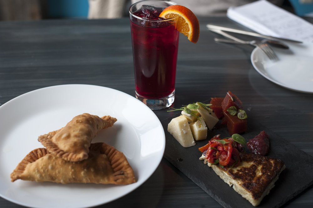 Babalu's classic baked empanadas and Guava Plate, along with a glass of non-alcoholic sangria.   Long Islander News Photo/File