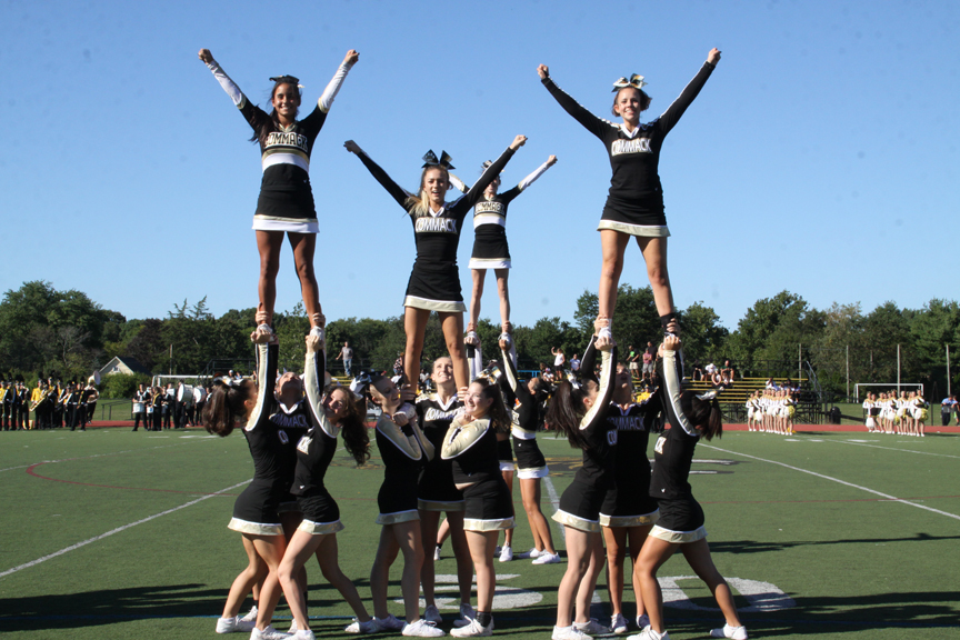 The Cougars cheerleaders pump up the crowd during halftime.   Photo/Commack School District