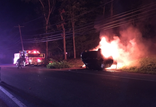 A car burns up on Bagatelle Road in Melville on Sunday, Oct. 1. Photo by Steve Silverman
