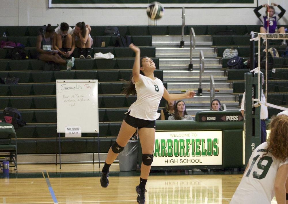 Senior outside hitter Bella Carr (no. 8) jumps to hit the ball over the net.   Long Islander News Photo/Janee Law