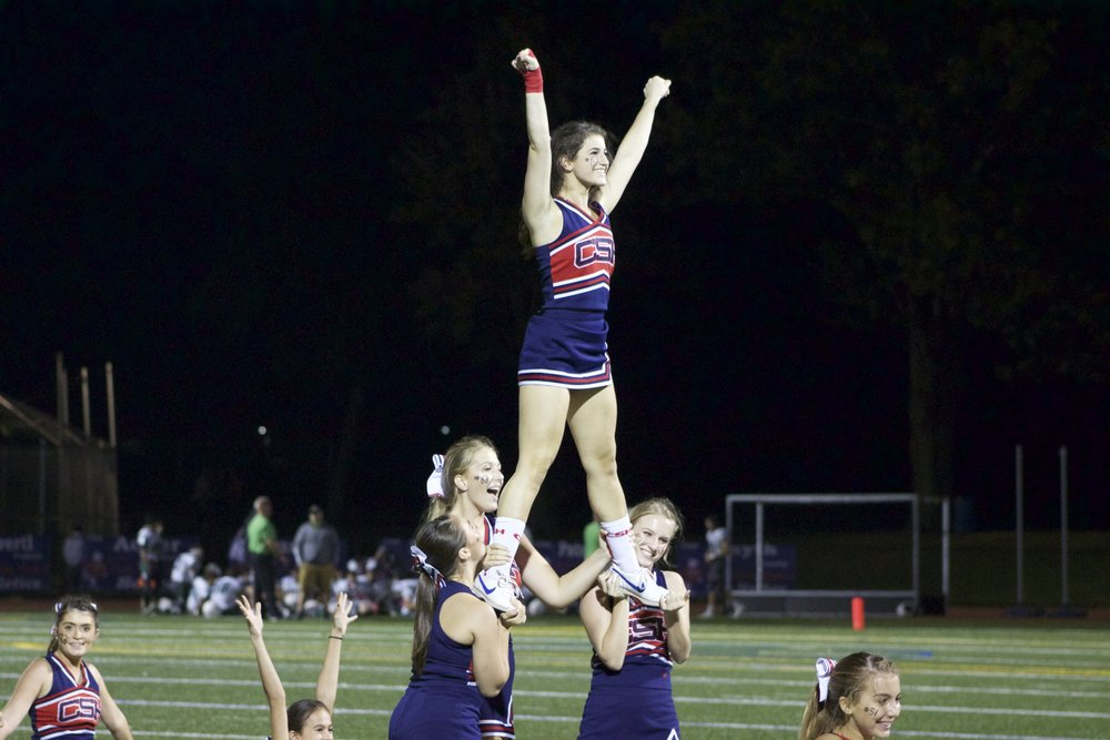 The Cold Spring Harbor cheerleaders pep up the crowd during the Seahawks' homecoming win.   Long Islander News Photo/Janee Law