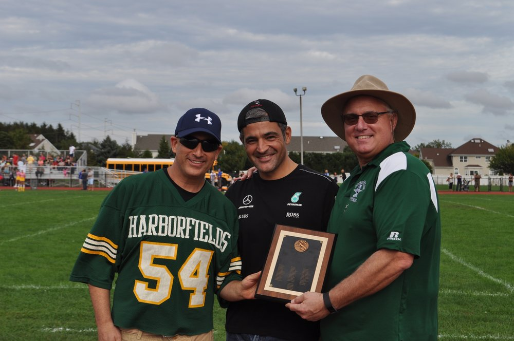 Members of the Harborfields High School Class of 1987 presented the school with the football team's 1987 Division V League Championship plaque at Saturday's football game.   Photo Courtesy of John Tilden