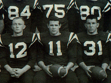 """Hon. W. Gerard """"Jerry"""" Asher, center, is pictured during his senior year campaign as Huntington football captain and quarterback."""