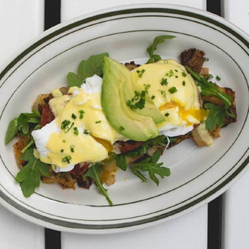 The eggs benedict at The Shed are served with arugula, roasted tomato and avocado.   Photo/Facebook/The Shed Restaurant