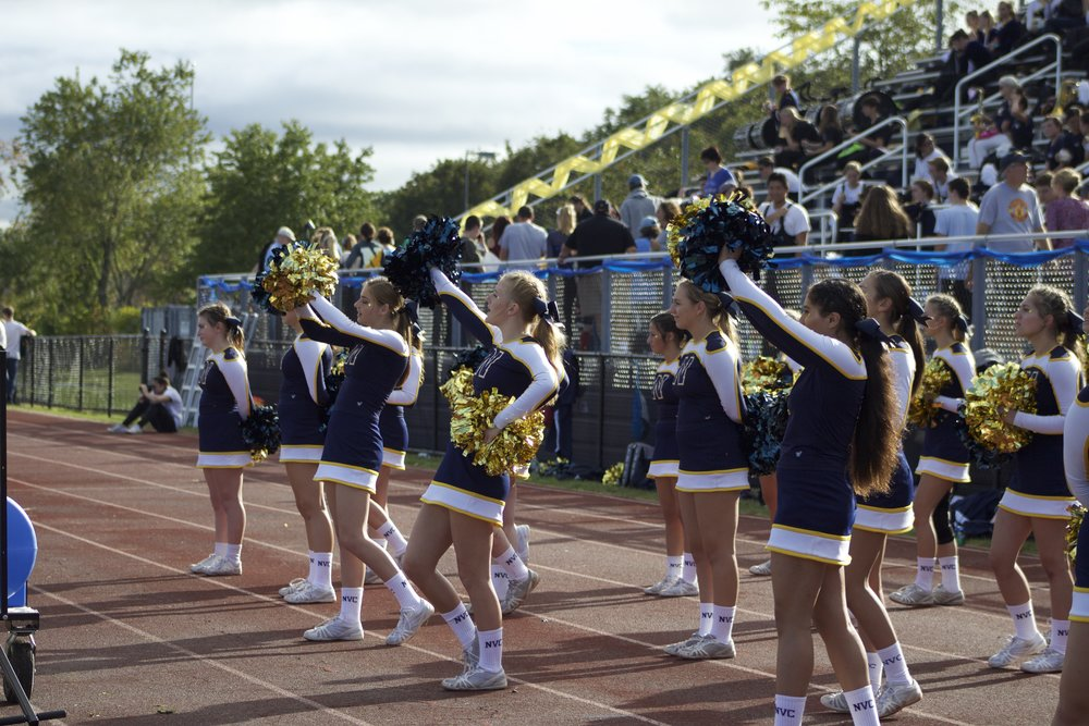 The Northport cheerleaders encourage the Tigers during Saturday's homecoming win.   Long Islander News Photo/Janee Law
