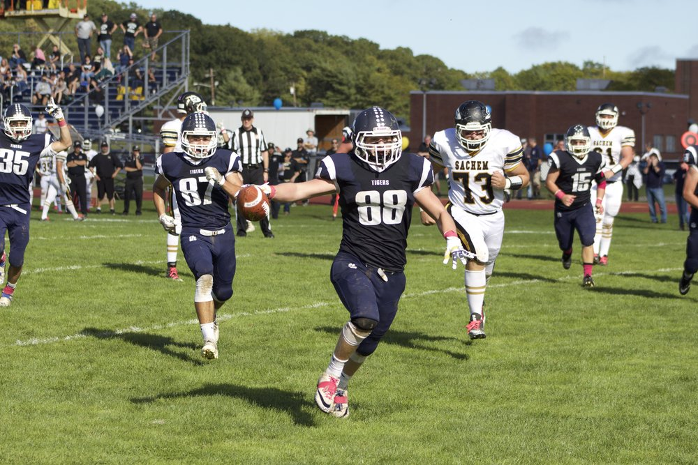 Andrew Bolitho (No. 88) runs back an interception for a 15-yard touchdown in the second quarter of Northport's homecoming game.   Long Islander News Photo/Janee Law