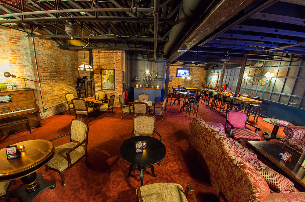 The Founder's Room, the exclusive members-only club at The Paramount, recreates a 1920's speakeasy with an urban-industrial-meets-old-world-craftsmanship style.