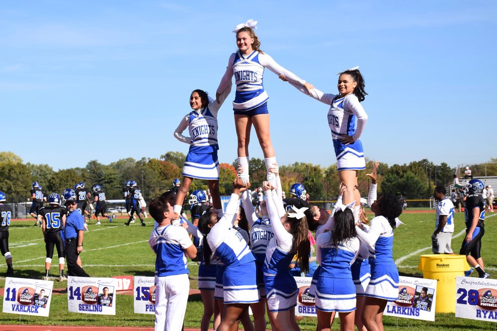 The Elwood cheerleaders excite the crowd at the Knights homecoming football game against Amityville.     Photo Courtesy of Elwood Union Free School District