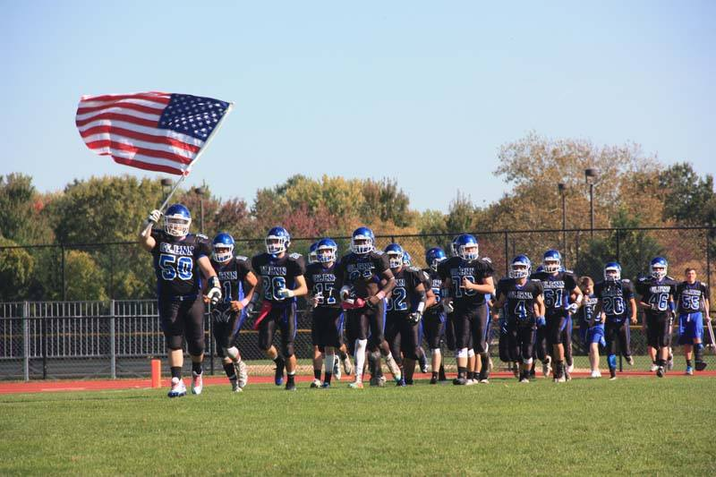 The Elwood Knights burst onto the field at their homecoming football game against Amityville.   Photo Courtesy of Elwood Union Free School District