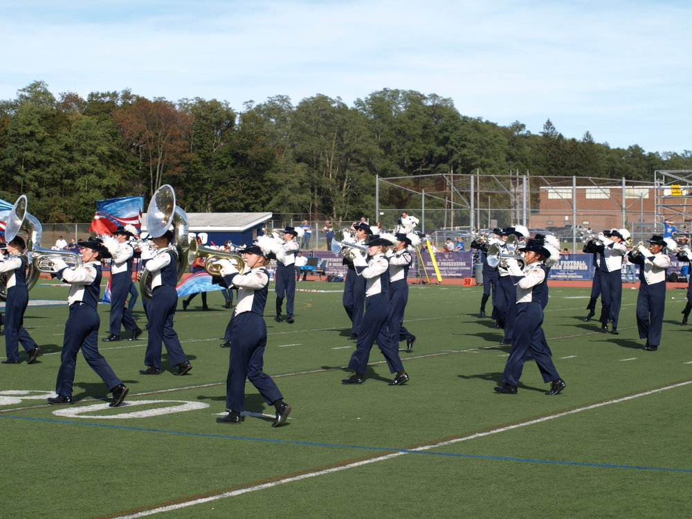"The Huntington Marching Band performs ""Americana"" for fans at halftime .  Long Islander News Photo/Connor Beach"