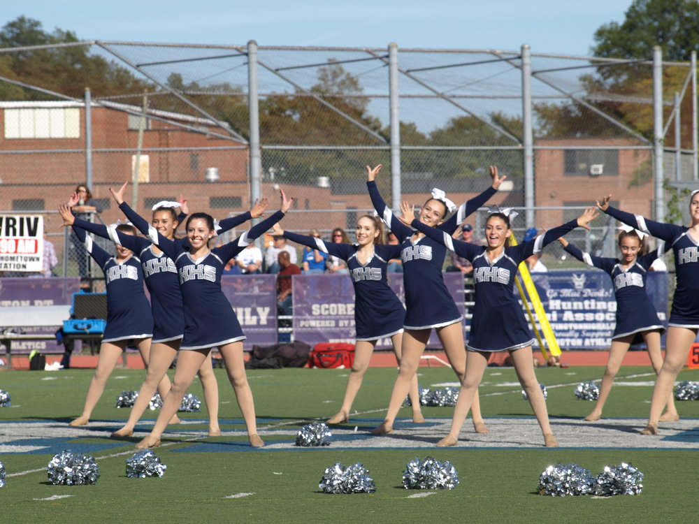The Huntington Highsteppers' routine energizes the spectators at Homecoming.   Long Islander News Photo/Connor Beach