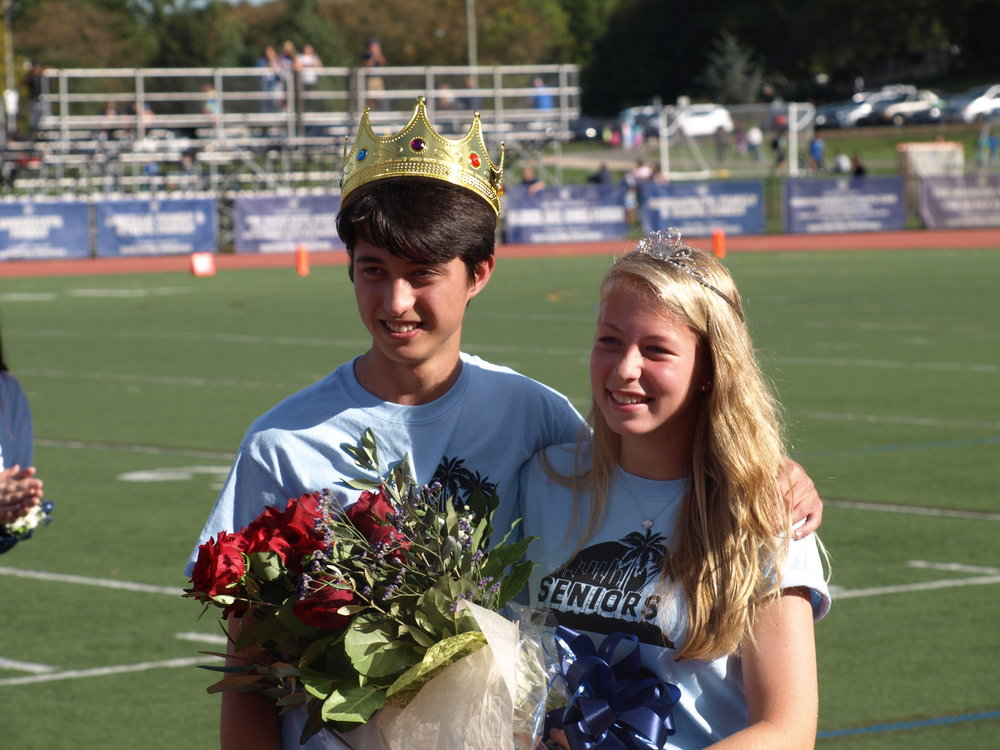 Homecoming king Ryan Smith, left, and Alexandra Lourenso, right, were crowned during halftime of the Blue Devil's 20-19 victory.   Long Islander News Photo/Connor Beach
