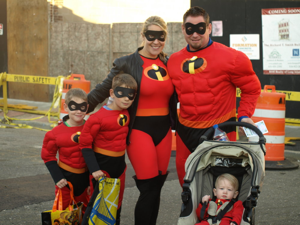 the incredible family enjoyed dressing up together for at the annual childrens halloween costume parade