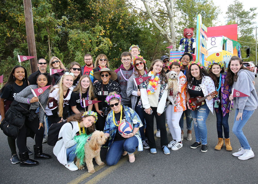 Members of Walt Whitman High School's senior class stop for a picture before continuing their march in the homecoming parade Saturday morning.   Photo by Steve Bartholomew