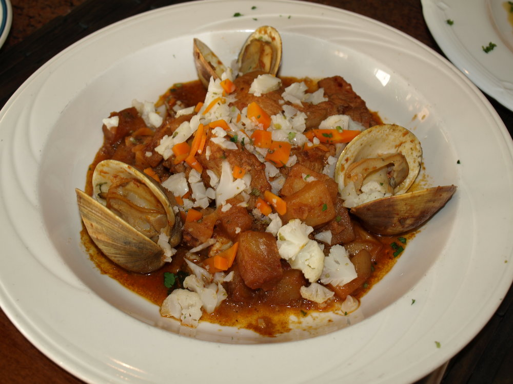 The Carne de Porco a Alentejana ($29) includes pork and whole clams stewed with potatoes and a roasted red pepper puree.   Long Islander News Photo/Connor Beach