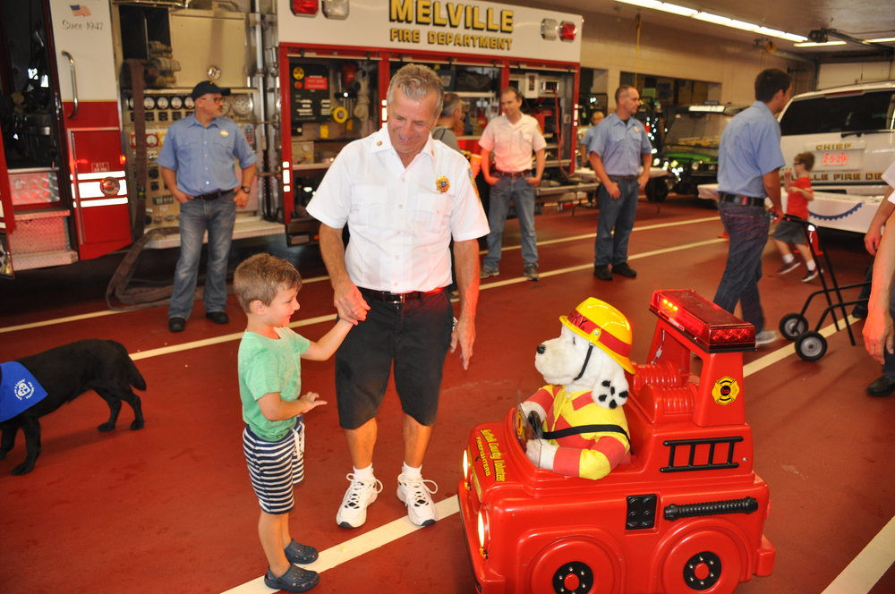 The open house drew hundreds, including families with children, who got to explore Melville fire headquarters.   Photo by Steve Silverman