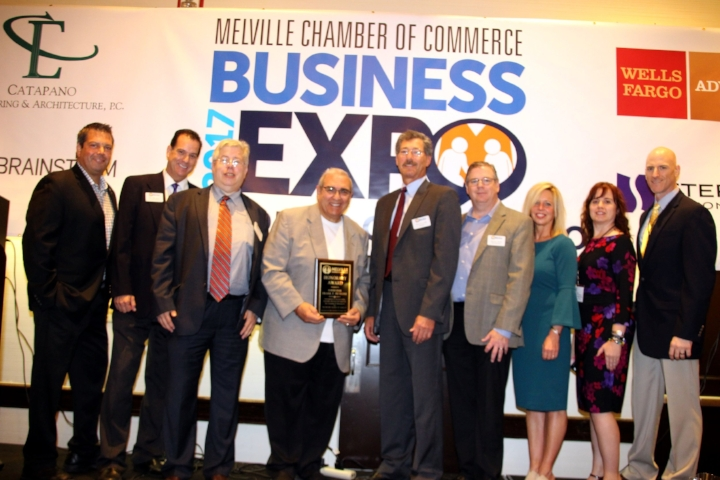 "The Melville Chamber of Commerce recently honored outgoing Huntington Supervisor Frank Petrone for his ""outstanding leadership, dedication and support of the Town of Huntington and The Melville Chamber of Commerce"" as part of the opening ceremonies for the chamber's Business Expo on Oct. 25. Pictured, from left, are: Mark Catapano, chairman of the chamber board; Ted Macaluso, executive director; Craig Levy, board member; Petrone; David Gustin, president; and board members Jerome Hehir, Krysti O'Rourke, Dawn Grzan and Mike Giambertone."