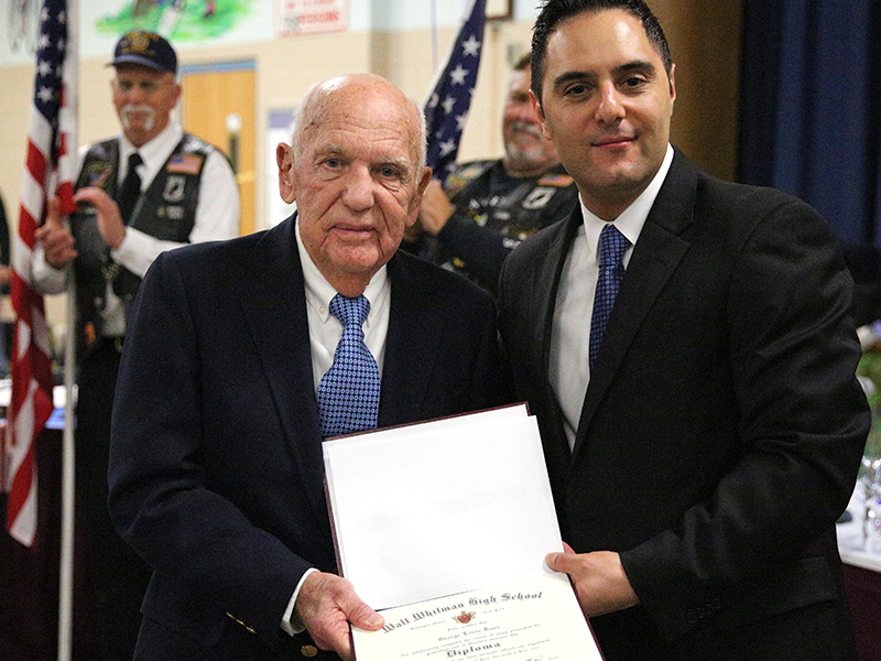 World War II veteran George Kunz, left, was presented with his high school diploma at 91 years old by South Huntington District BOE President Nicholas Ciappetta.  Photo by Steve Bartholomew