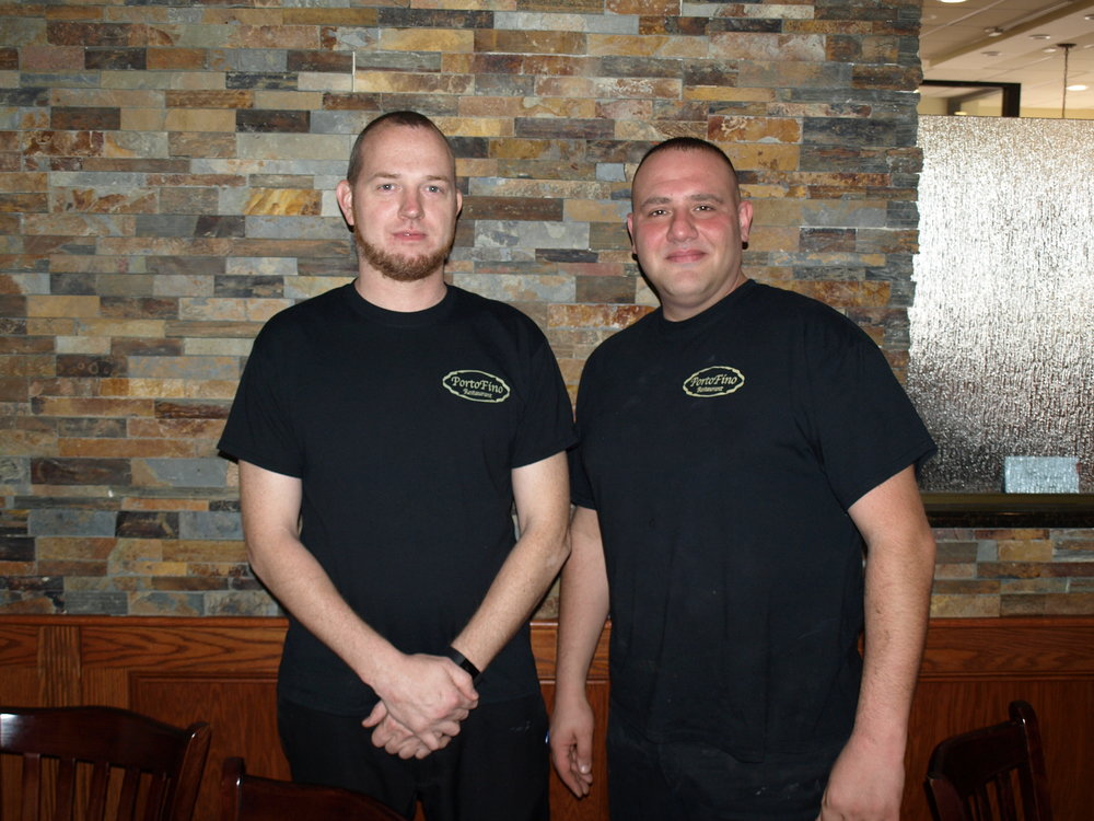 Porto Fino owner Gianni Vigliotti, right, and his first employee Tim Grill have been serving up Italian favorites in Huntington since 2012.   Long Islander News Photo/Connor Beach