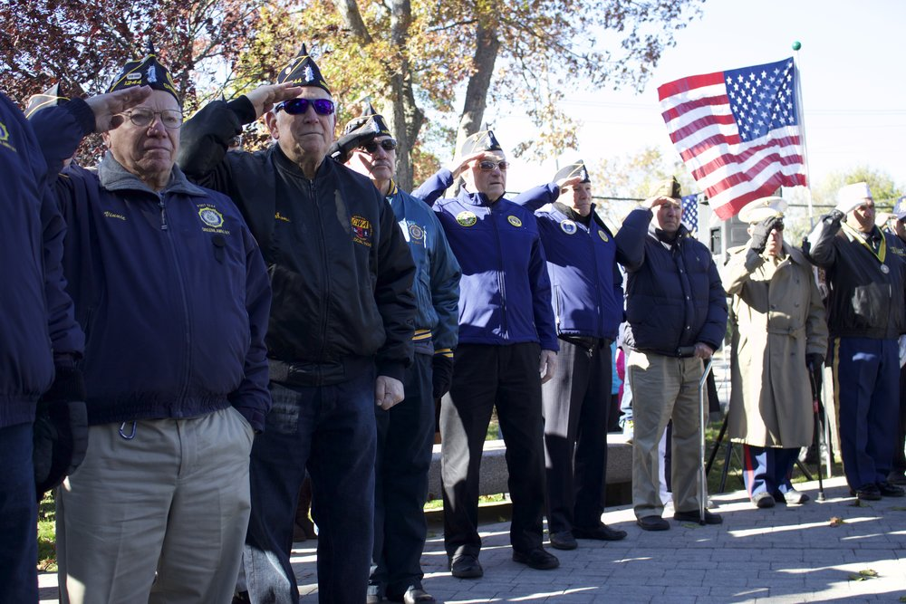 Veterans salute during the presentation of the wreaths at the Veterans Day Ceremony at Greenlawn Memorial Park.   Long Islander News Photo/Janee Law