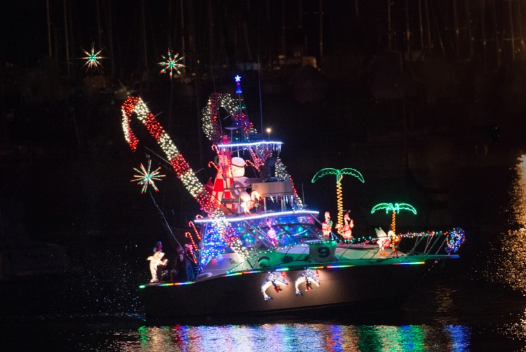 The Huntington Lighthouse Boat Parade features boats and houses furnished with festive holiday decorations  .   Photo Courtesy of Pam Setchell