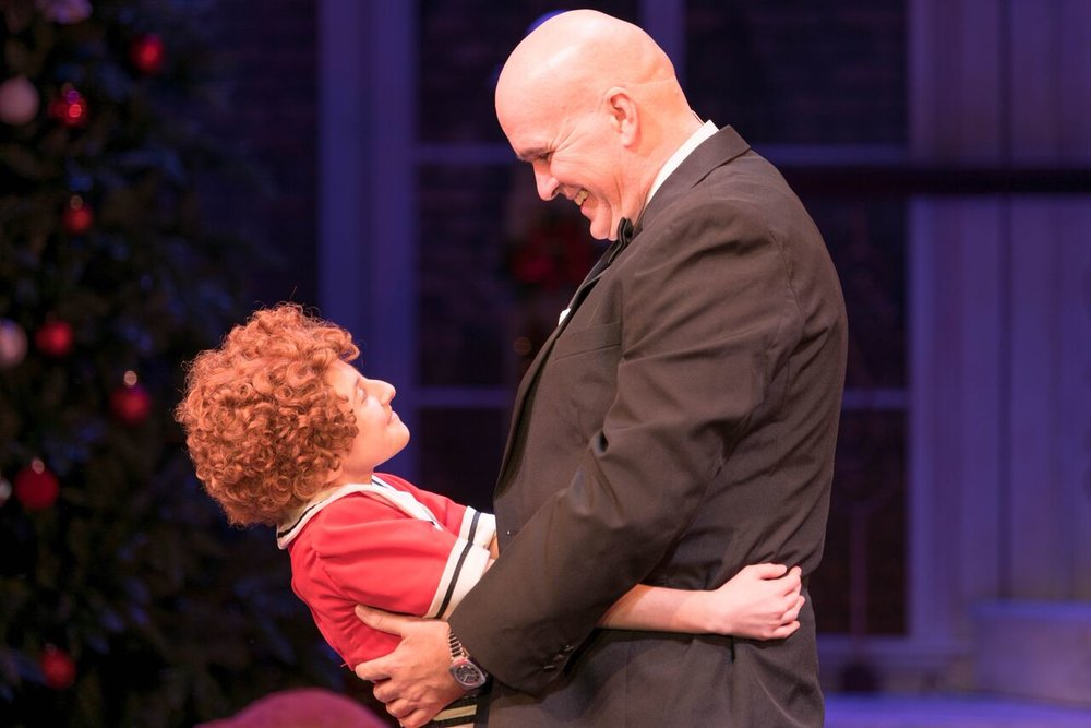 """Presley Ryan (as Annie) and George Dvorsky (as Oliver """"Daddy"""" Warbucks) melt hearts in Engeman's production of """"Annie.""""   Photo by Michael DeCristofaro"""